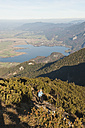 Germany, Bavaria, Senior woman at heimgarten and herzogstand mountain ranges - MIRF000086
