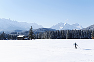 Germany, Bavaria, Isar Valley, Senior woman doing cross country skiing - MIRF000088
