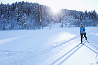 Germany, Bavaria, Isar Valley, Senior woman doing cross country skiing - MIRF000094