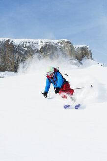Austria, Kleinwalsertal, Woman skiing - MRF001244