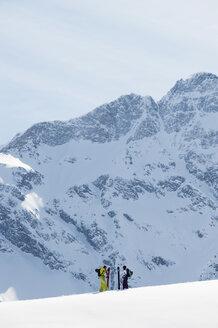 Austria, Kleinwalsertal,  Couple skiing - MRF001256