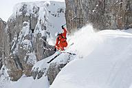 Austria, Kleinwalsertal, Man jumping on ski - MRF001271