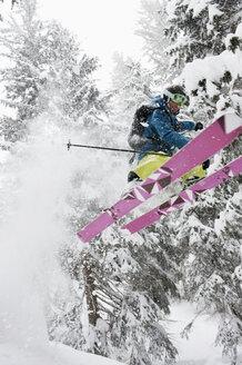 Austria, Kleinwalsertal, Male skier jumping mid-air - MRF001277