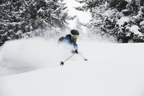 Austria, Kleinwalsertal, Man skiing, low angle view - MRF001280