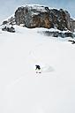 Austria, Kleinwalsertal,  Man skiing, elevated view - MRF001283