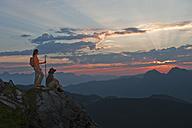 Austria, Salzburg Country, Altenmarkt-Zauchensee, Couple watching sunrise on mountains of Niedere Tauern - HHF003586