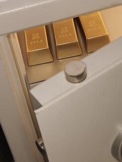 Three pieces of gold bullion in locker, close up - AKF000237