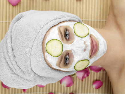 Young woman with face mask at spa, portrait - JLF000354