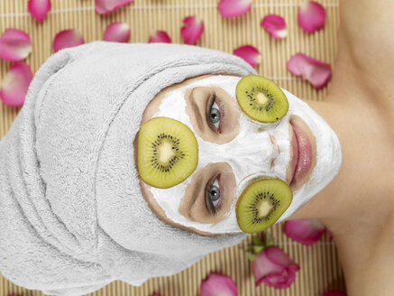 Young woman with face mask at spa, portrait - JLF000355