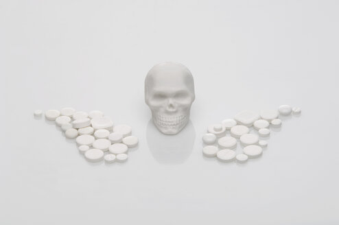 Skull, pills and drugs forming wings shape on white background - ASF004304