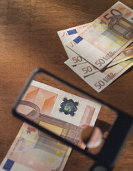 Fifty euro note under magnifying glass - WBF001020