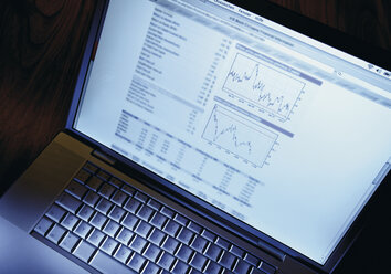 Share prices on laptop screen, close up - WBF001032