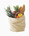 Shopping bag with healthy foods against white background - WBF001053