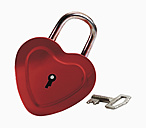 Heart shaped lock and key against white background, close up - WBF001083