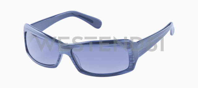Blue sunglasses against white background, close up - WBF001153