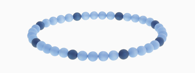 Bracelet of blue beads against white background, close up - WBF001188