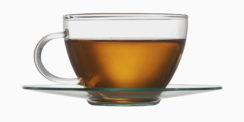 Glass tea cup with tea against white background, close up - WBF001203