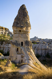 Turkey, Cappadocia, Goreme, View of rock formation at the edge of town with uchisar - PSF000513