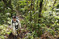 Costa Rica, Las Horquetas, Rara Avis, Woman with backpack in rainforest - SIEF001126