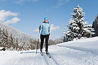 Germany, Bavaria, Aschermoos, Senior woman doing cross-country skiing - MIRF000103