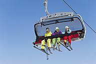Italy, Trentino-Alto Adige, Alto Adige, Bolzano, Seiser Alm, Group of skiers using ski lift - MIRF000127