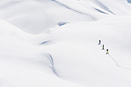 Italy, Trentino-Alto Adige, Alto Adige, Bolzano, Seiser Alm, Group of people on ski tour - MIRF000136
