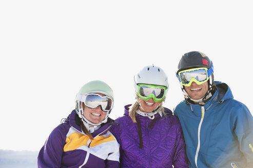 Italy, Trentino-Alto Adige, Alto Adige, Bolzano, Seiser Alm, Group of people skiing, smiling - MIRF000145