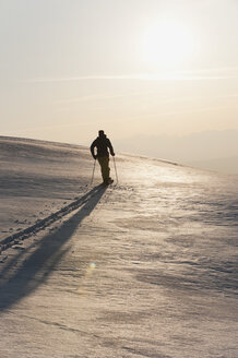 Italy, Trentino-Alto Adige, Alto Adige, Bolzano, Seiser Alm, Mid adult man on ski tour in morning - MIRF000148
