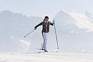 Italy, Trentino-Alto Adige, Alto Adige, Bolzano, Seiser Alm, Mid adult woman doing cross-country skiing - MIRF000160