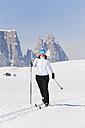 Italy, Trentino-Alto Adige, Alto Adige, Bolzano, Seiser Alm, Senior woman doing cross-country skiing - MIRF000169