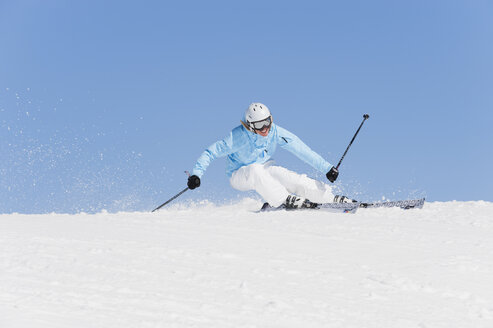 Italy, Trentino-Alto Adige, Alto Adige, Bolzano, Seiser Alm, Young woman skiing - MIRF000175