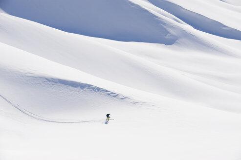 Italy, Trentino-Alto Adige, Alto Adige, Bolzano, Seiser Alm, Mid adult man on ski tour - MIRF000178