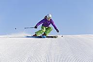 Italy, Trentino-Alto Adige, Alto Adige, Bolzano, Seiser Alm, Young woman skiing - MIRF000190