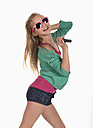 Girl with sunglasses dancing and singing against white background, smiling - WWF001910