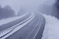 Germany, Upper Bavaria, Bundesautobahn 95, View of fog and snow on empty highway - TCF001441