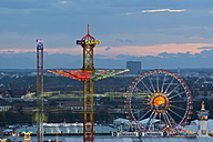 Germany, Bavaria, Munich, View of Oktoberfest fair at dusk - FO003324