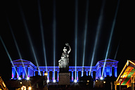 Germany, Bavaria, Munich, Illuminated bavaria statue and hall of fame during oktoberfest at night - FO003334