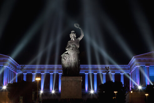 Germany, Bavaria, Munich, Illuminated bavaria statue and hall of fame during oktoberfest at night - FO003336