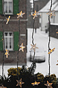 Germany, Cologne, Close up of illuminated stars as christmas window decoration - GWF001452