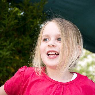 Germany, Bavaria, Girl looking away, smiling - LFF000233