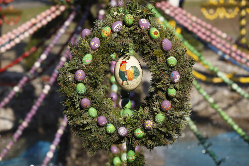 Germany, Bavaria, Franconia, Upper Franconia, Franconian Switzerland, Bieberbach, Easter egg decoration of easter well, close up - SIEF001460