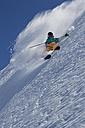 Austria, Tyrol, Pitztal, Mature man doing freestyle skiing - FFF001160