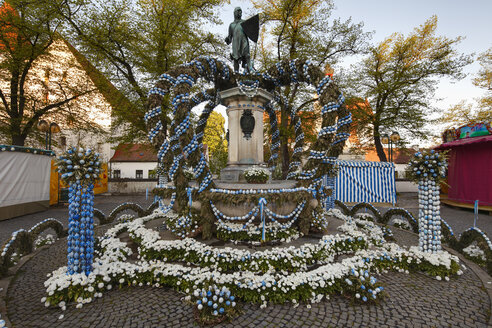 Germany, Bavaria, Upper Bavaria, Ingolstadt, Paradeplatz, View of fountain and statue decorated with easter eggs - SIE001517