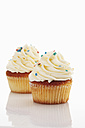 Close up of buttercream vanilla cupcake against white background - CSF015010