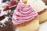 Close up of buttercream strawberry cupcake against white background - CSF014998