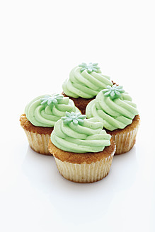 Close up of buttercream woodruff cupcake against white background - CSF014978