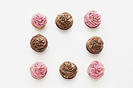 Strawberry and chocolate buttercream cupcakes against white background - CSF014946