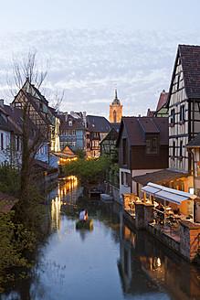 France, Alsace, Colmar, Krutenau, View of La Petite Venise quarter and people in boat at Launch river - WDF000894