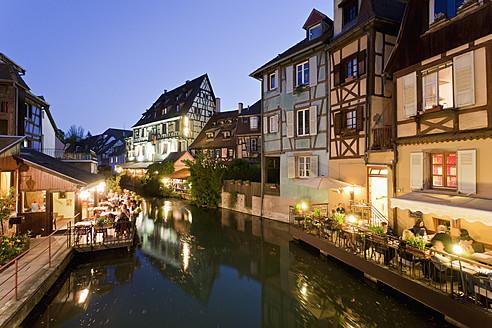 France, Alsace, Colmar, Krutenau, View of La Petite Venise quarters with restaurant near Lauch river at night - WDF000892