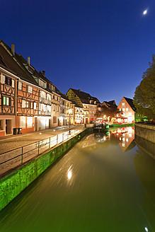 France, Alsace, Colmar, Krutenau, Quai de la Poissonnerie, View of La Petite Venise quarters with restaurant near Lauch river at night - WDF000889